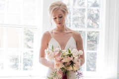 Rose-and-Laurel-Minnesota-Wedding-and-Event-Florist-Classically-Striking-Floral-Design-5-Bride-holding-anemone-bouquet
