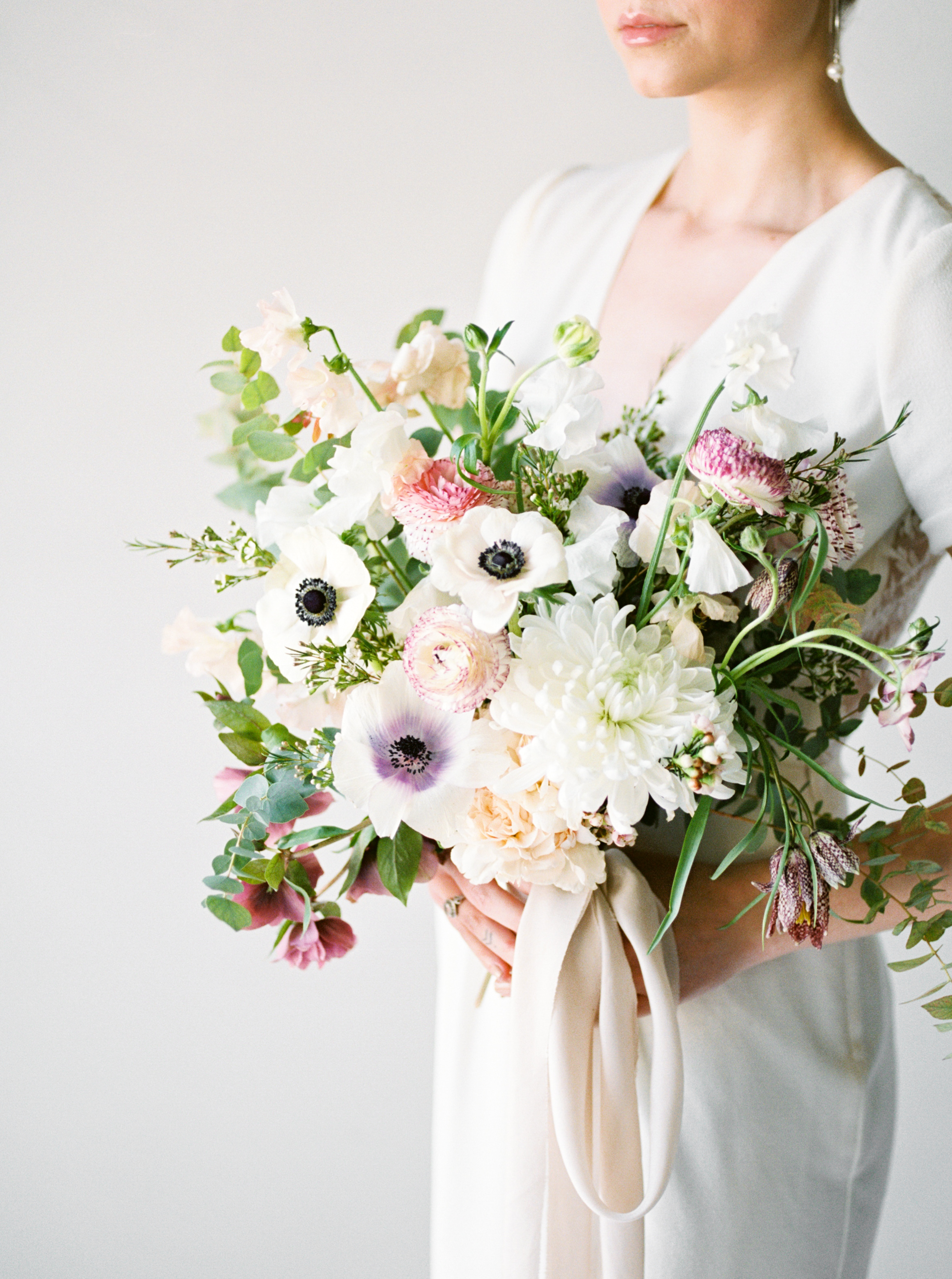 Rose-and-Laurel-Minnesota-Wedding-and-Event-Florist-Classically-Striking-Floral-Design-Spring-Anemone-Bridal-Bouquet