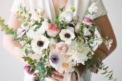 Rose-and-Laurel-Minnesota-Wedding-and-Event-Florist-Classically-Striking-Floral-Design-1-Bride-holding-anemone-bouquet