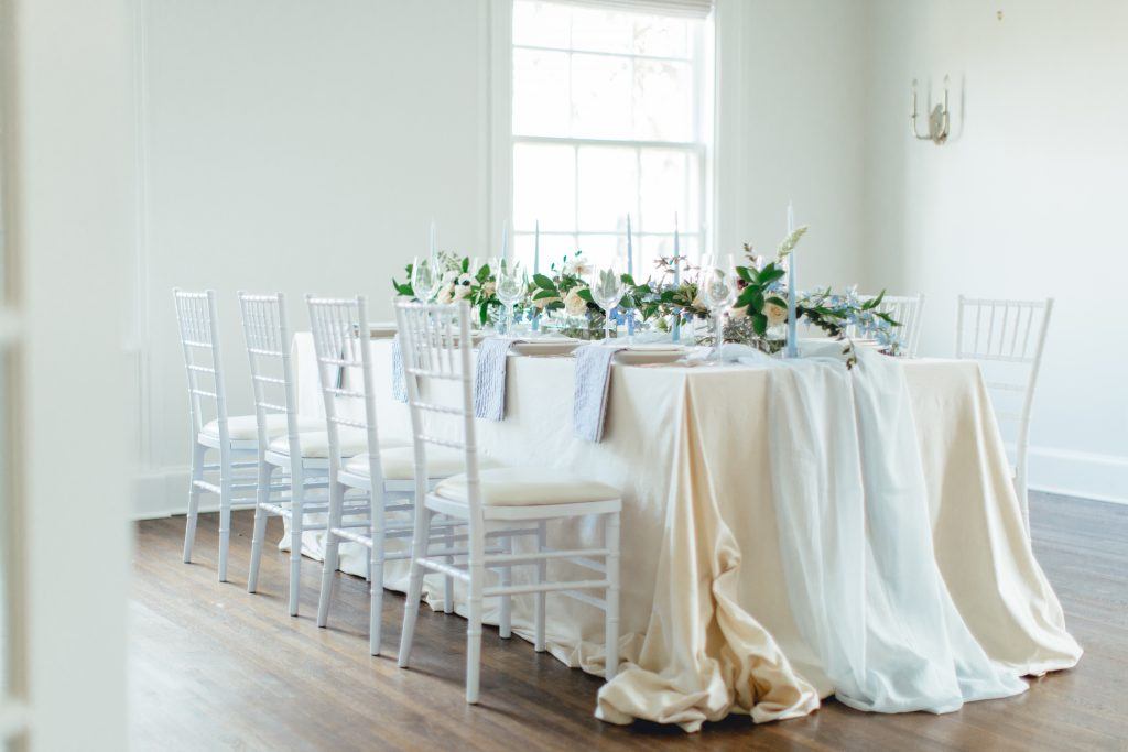 pulled back photo of wedding table in shades of blue