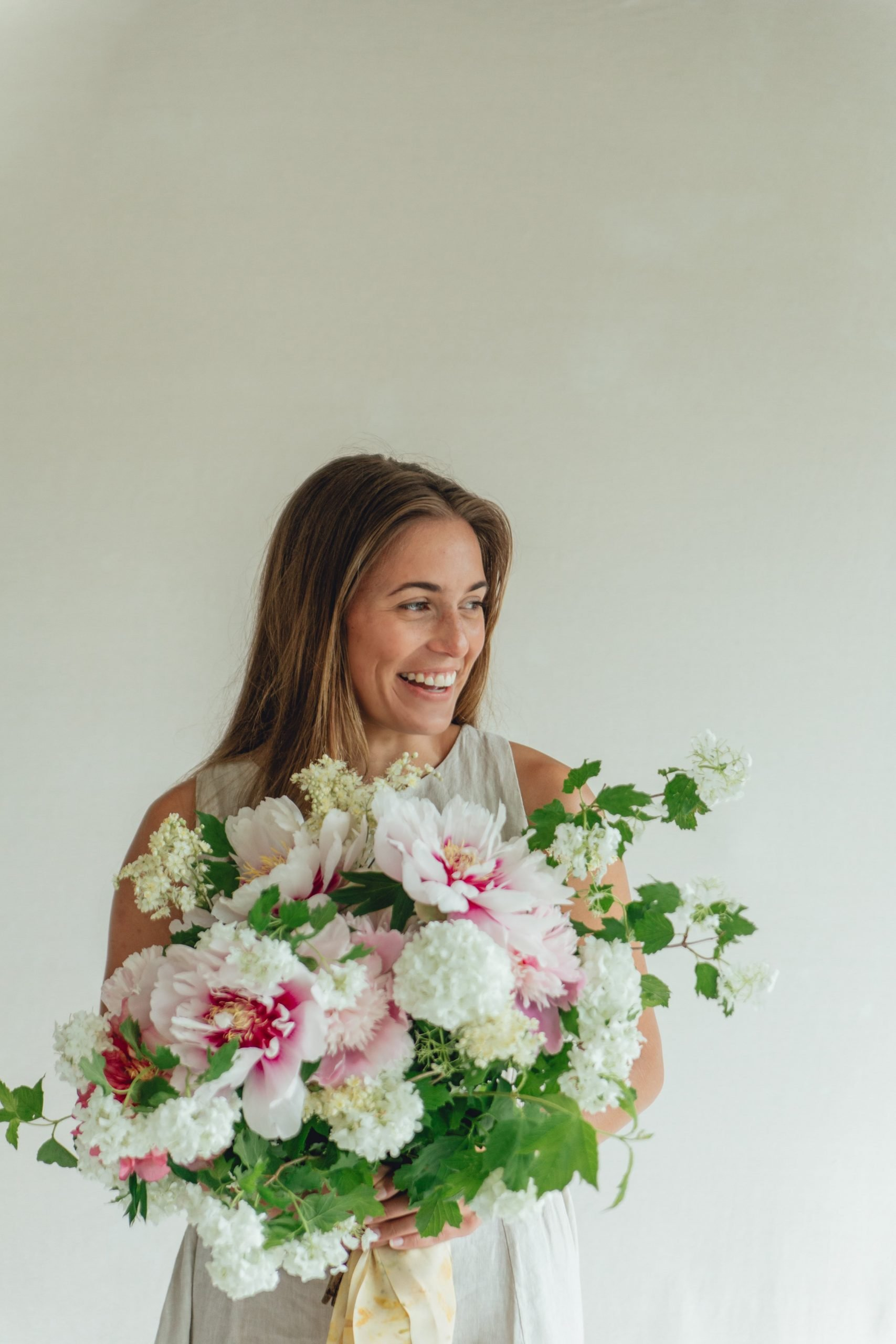 Rose_and_Laurel_Smiling_girl_holding_ Spring_bouquet_in_shades_of_pink