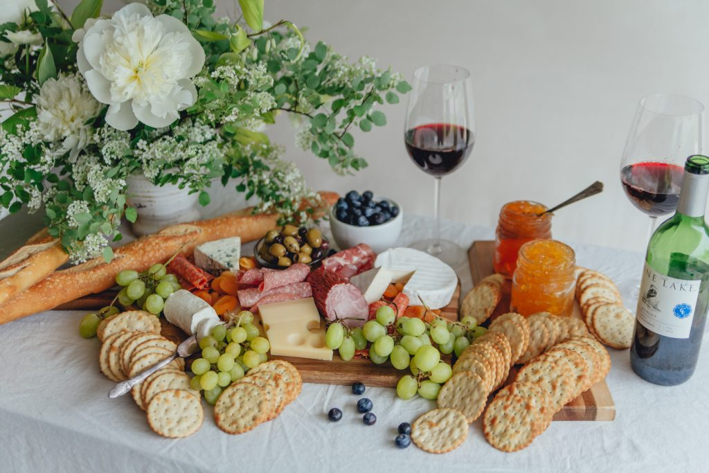 close-up-of-meat-and-cheese-board-with-wine-and-cheese