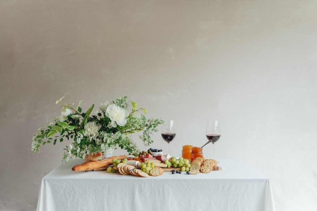 charcuterie-display-on-table-with-cream-background