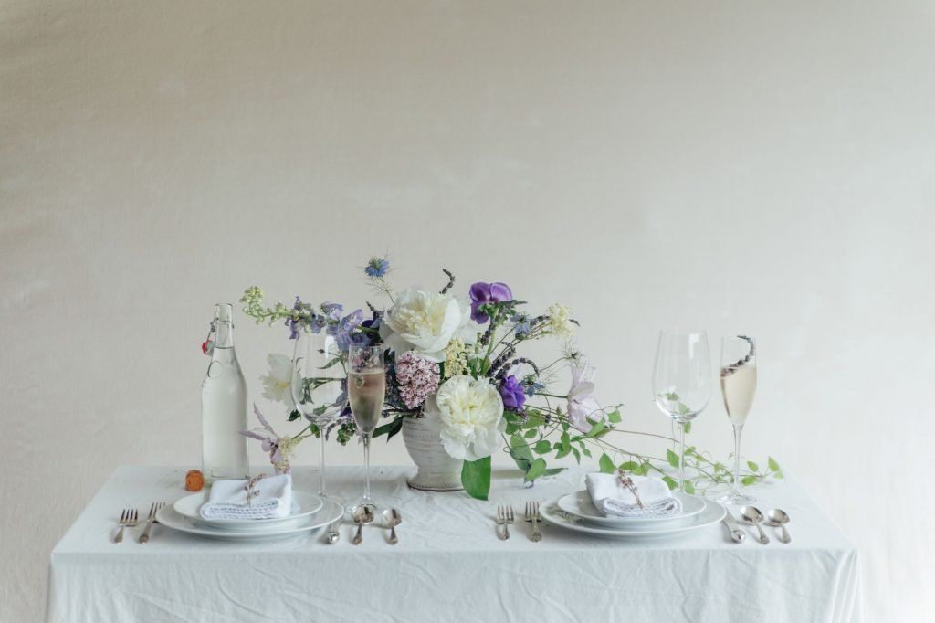 table-set-for-two-with-lavender-centerpiece-in-the-center
