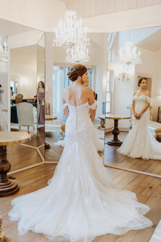 Bride-looking-into-three-way-mirror