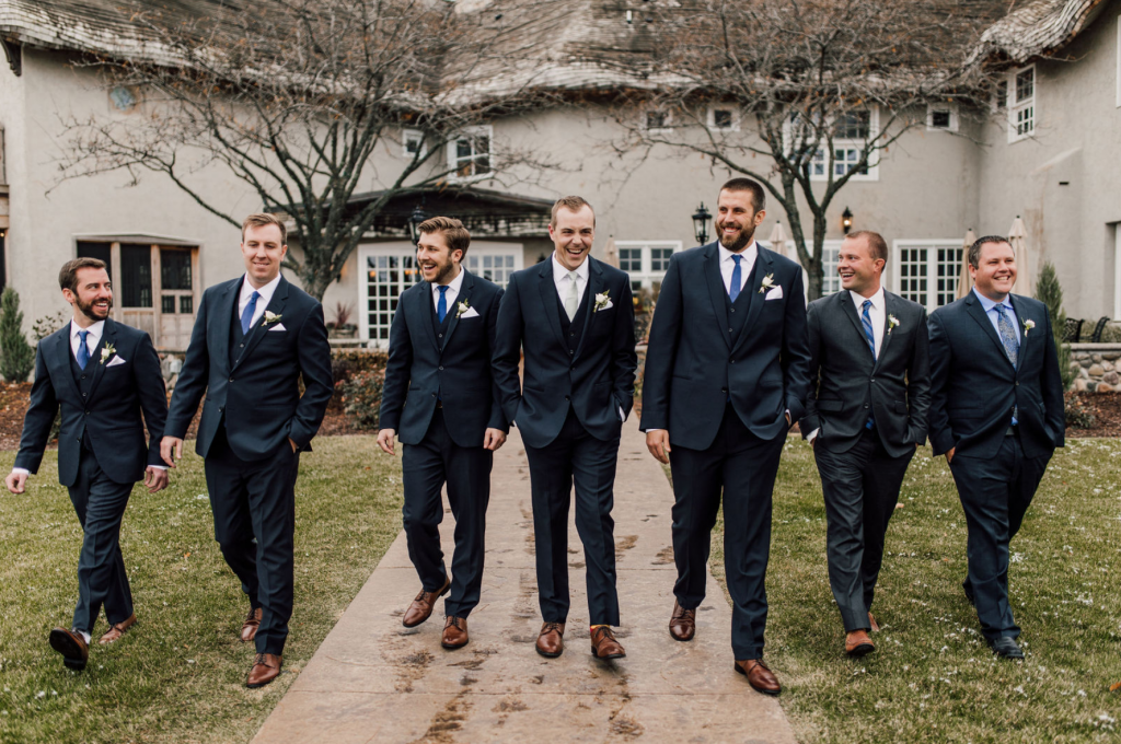 groom-and-groomsmen-as-they-walk-outside