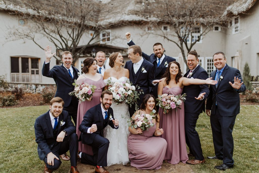 bridal-party-cheering-with-bride-and-groom-in-center
