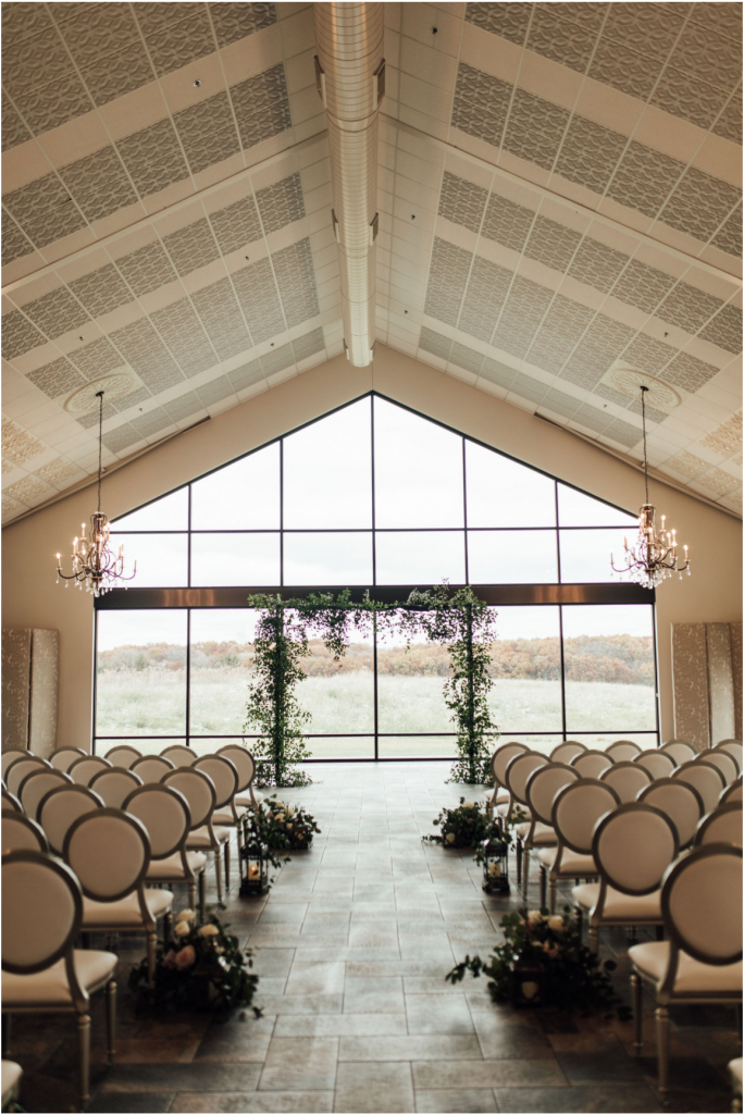 ceremony-indoors-with-wall-of-windows-behind