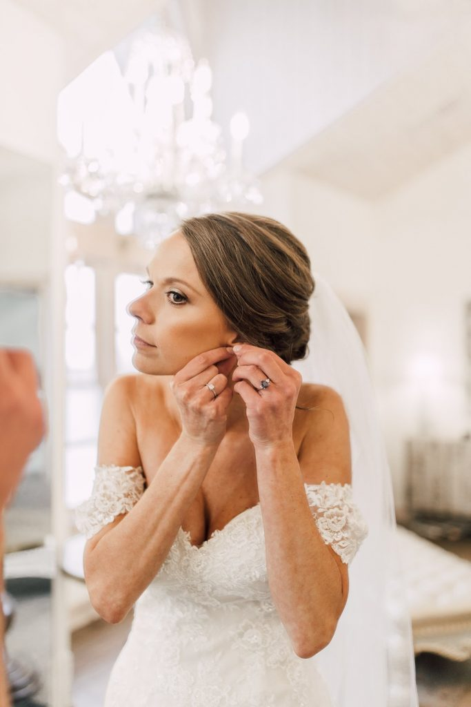 bride-putting-on-her-earring